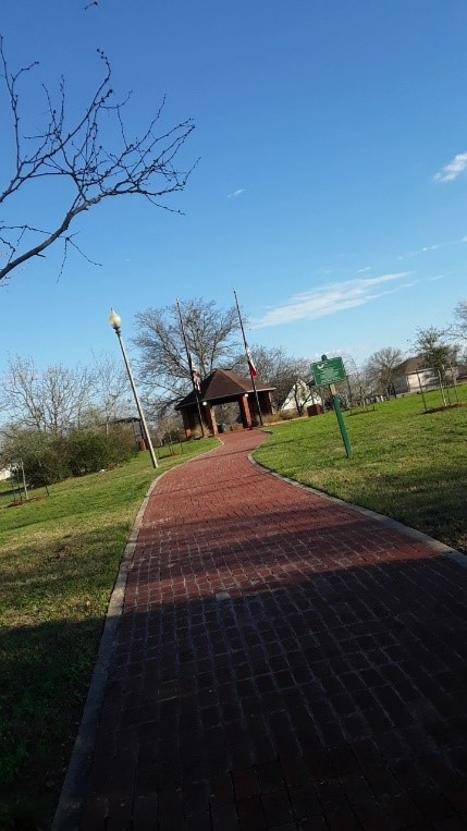 This is a picture of the park and the gazebo from the street entrance.