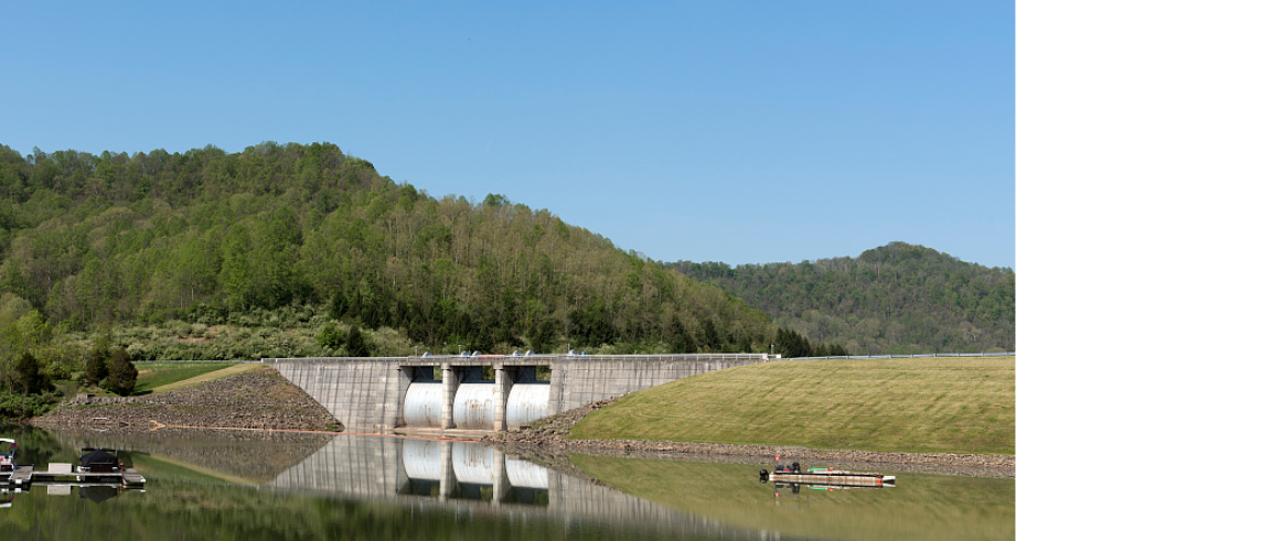 The dam spillway from lakeside.