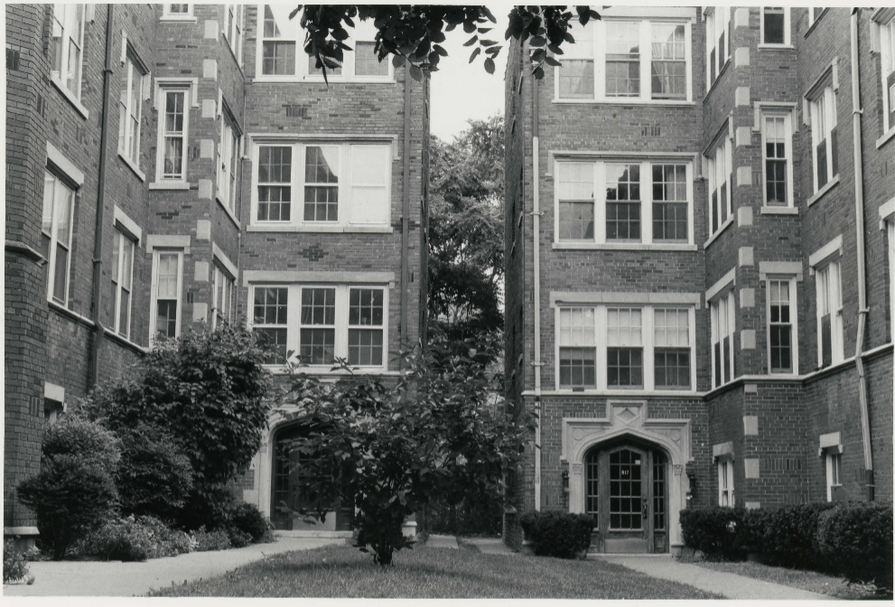 September 1983 - Close-up view of two apartment complexes with shared courtyard.