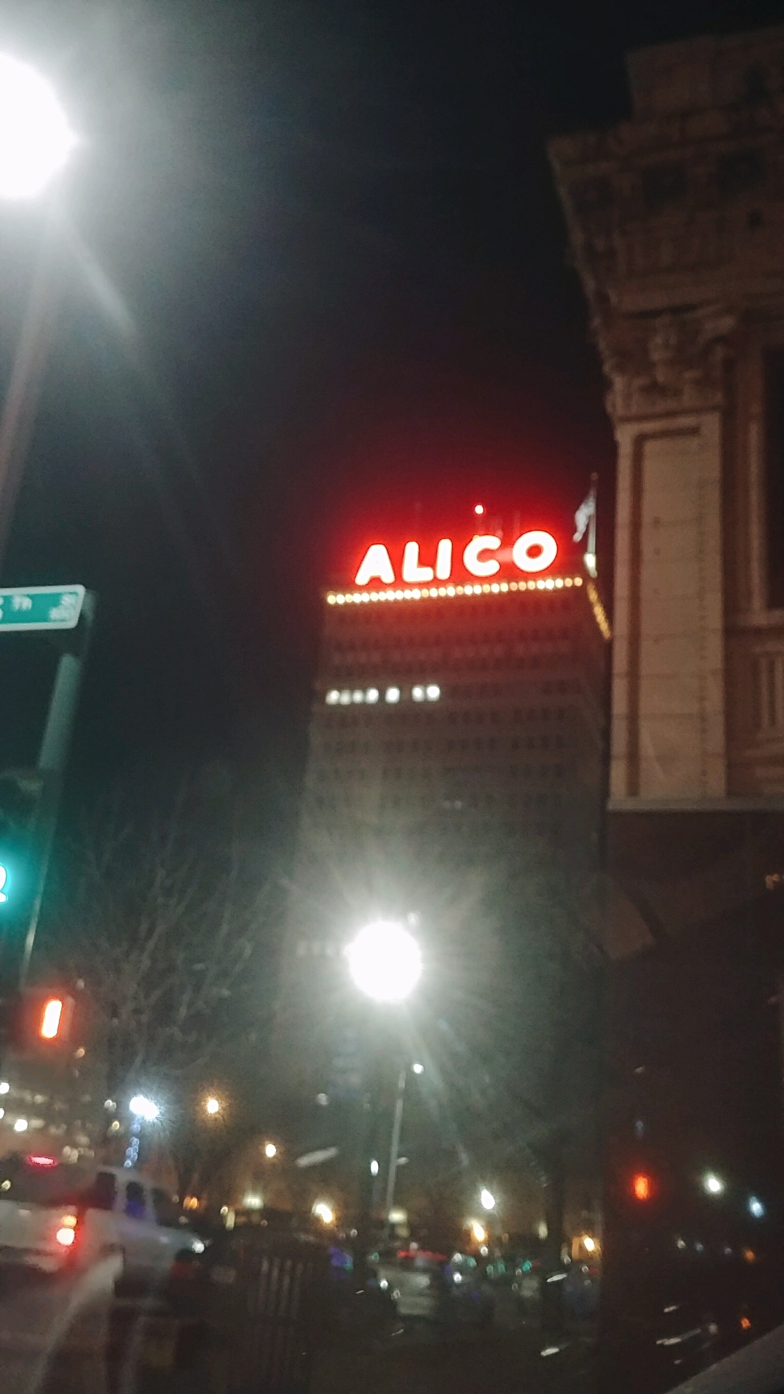 Front side of the ALICO Building with its glowing red letters