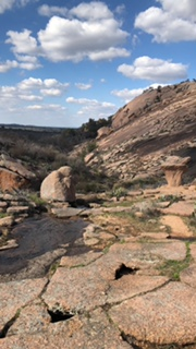Ground view in the middle of Enchanted Rock dome and Little Rock dome.