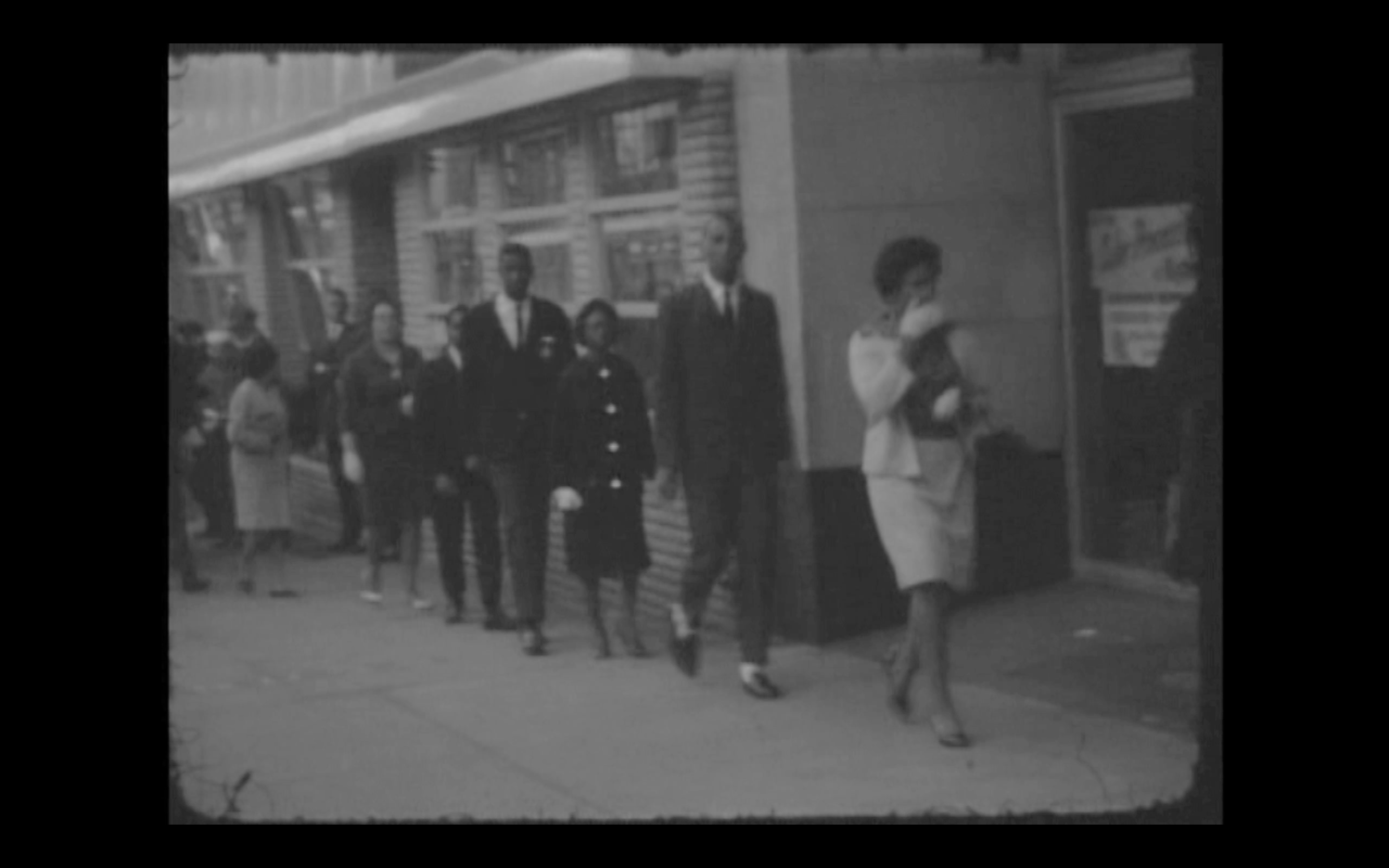 The picketing taking place outside of Bailey's on May 1, 1963.