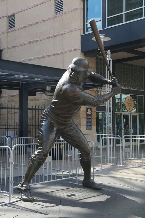 The statue outside of the stadium