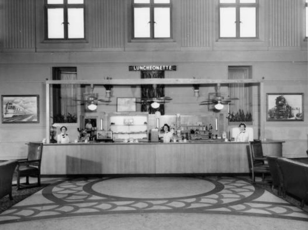 The lunch counter in the station in 1940. Bostwick, Louis, and Homer Frohardt. Burlington Railroad; Lunch Counter at Burlington Station. 1940. Bostwick-Frohardt Collection, The Durham Museum, Omaha.
