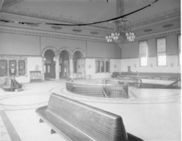 An empty waiting area in the early 20th century.  Bostwick, Louis, and Homer Frohardt. Burlington Railroad. 1910-1913. Bostwick-Frohardt Collection, The Durham Museum, Omaha.