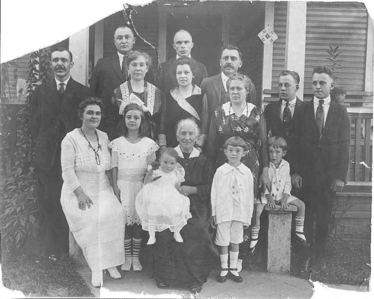 Belgian immigrants Arthur and Gustave Dupierreux and their families in South Charleston, circa 1915.