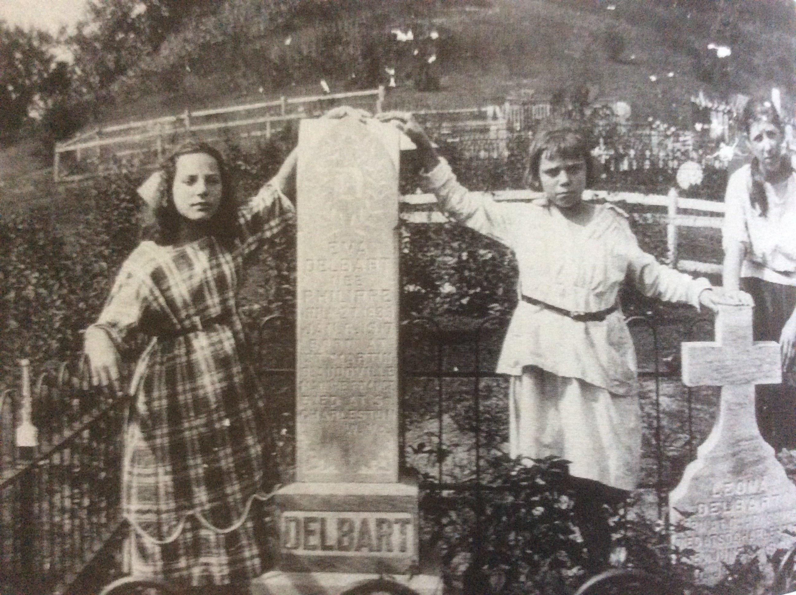 Around 1918, three Belgian girls pose in the Glendale Cemetery.