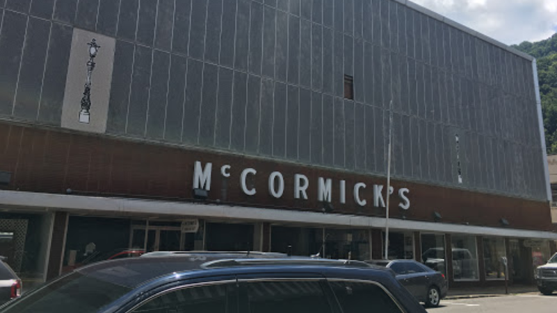 In the photo is McCormick's Furniture as it stands today. The business remains on the busy street corner beside of the Logan County Commission and the Logan Courthouse. 