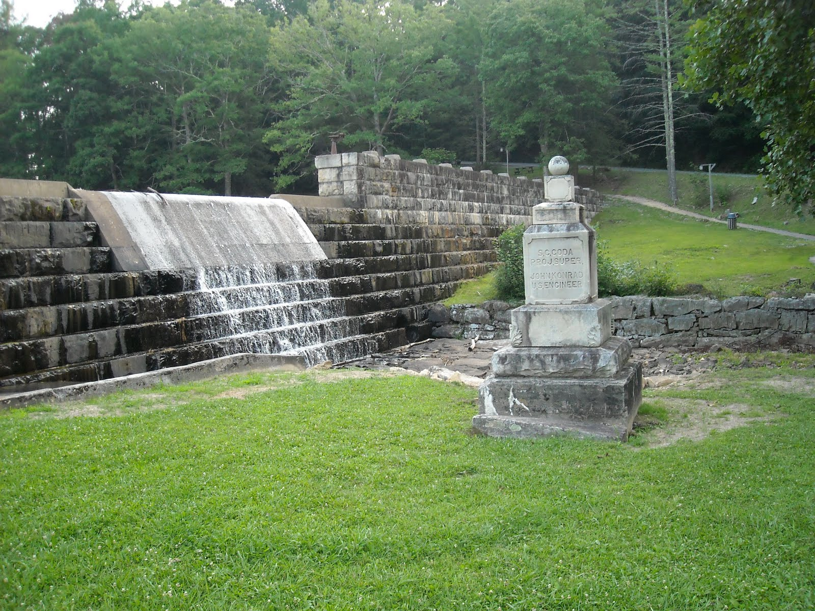 The dam and the monument to the men who built the camp from CCC Raleigh. Attribution: Tom Hoffman
