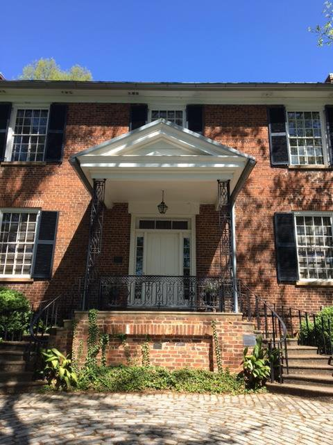Front of original 1857 building in the garden. Originally a home for professors, it has been a sorority house, women's dormitory, departmental office, and dining hall. It is now a part of the headquarters of the Garden Club of Georgia.