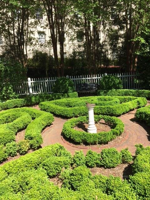 The boxwood garden area. A garden area set up as labyrinth of shrubbery with labelled plants along the edges. An old sundial stands in the middle as an aesthetic reminder of the past.