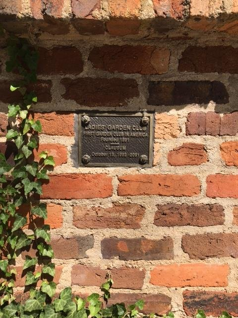 A tribute on the outside of the home to the original Ladies Garden Club founded in 1891.