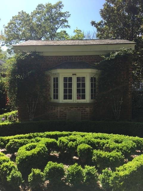 The back of the headquarters room and the other view of the boxwood garden.