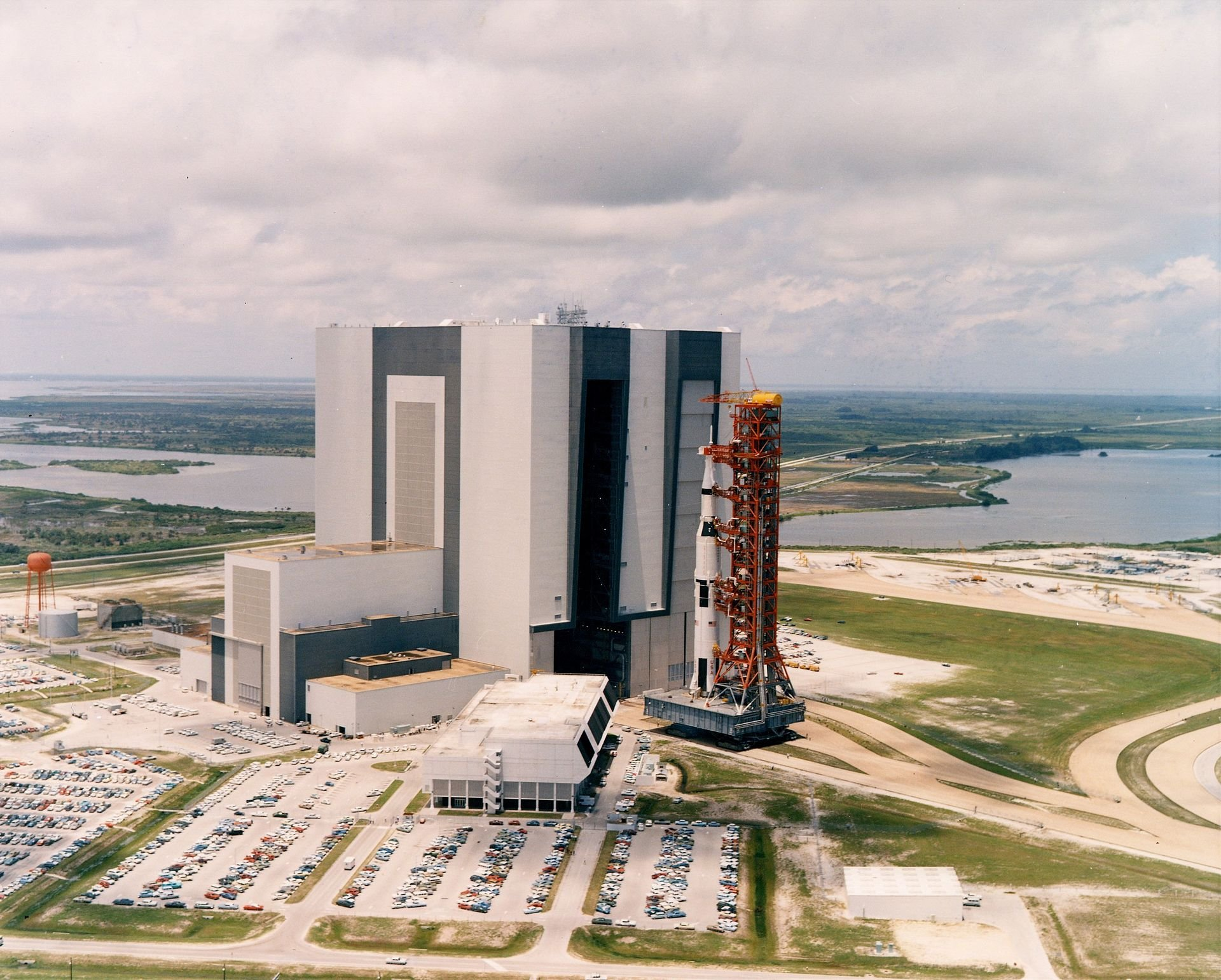 The Apollo 11 Saturn V rolls out of the KSC's Vehicle Assembly Building in May 1969. The world's largest single-story building, the VAB made it possible to fully assemble vehicles like the Saturn V and Space Shuttle. Courtesy of NASA.