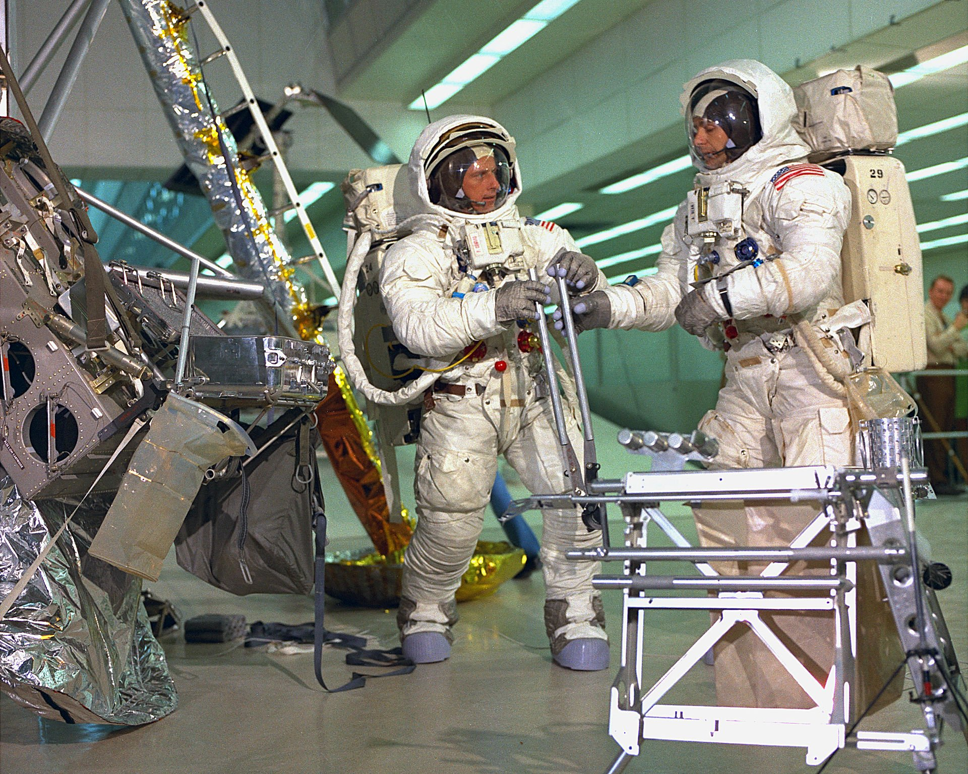 Apollo 12 astronauts Pete Conrad and Alan Bean simulate an EVA (Extravehicular Activity) at the Flight Crew Training Building. Courtesy of NASA.