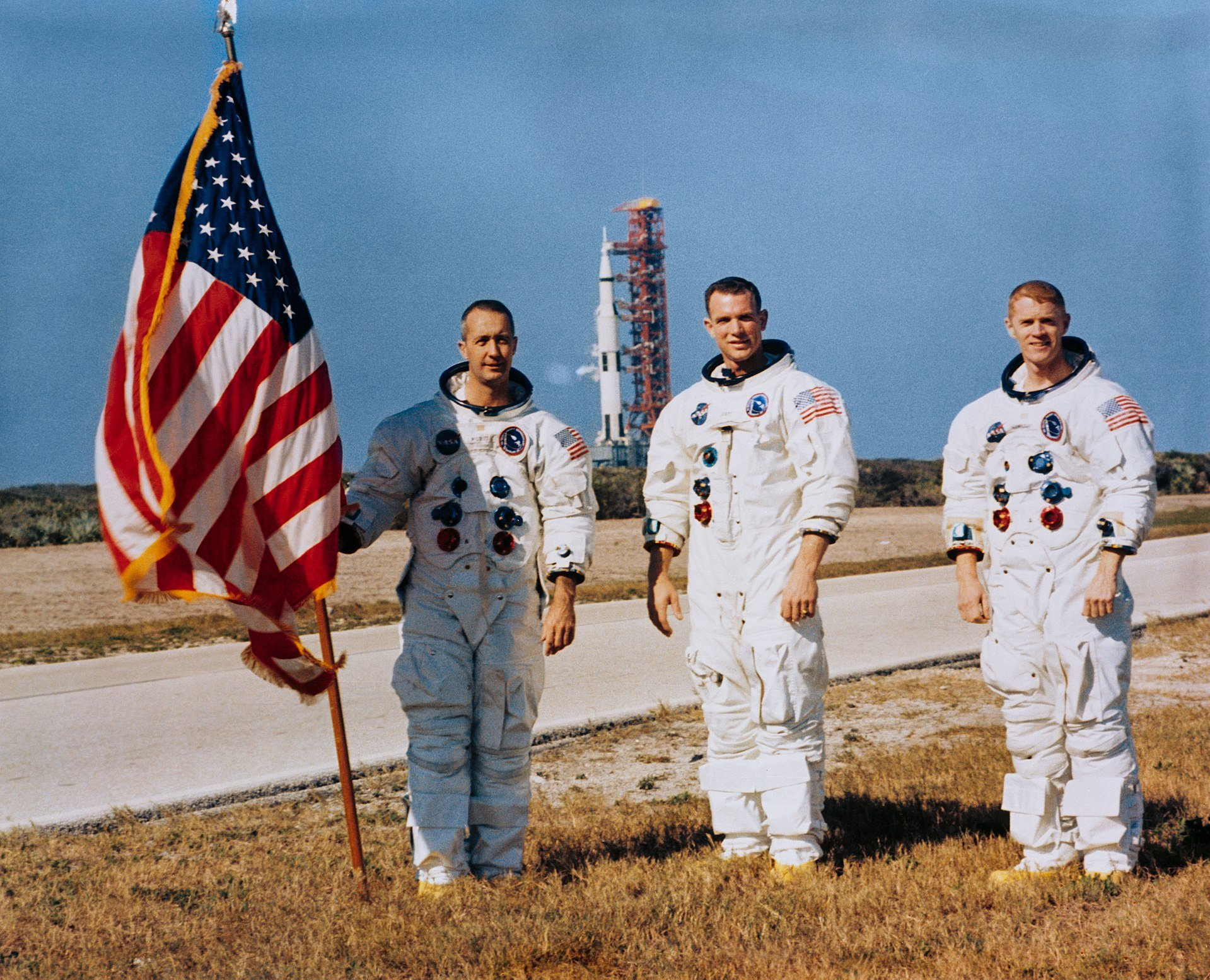 Apollo 9's James McDivitt, David Scott, and Russell Schweickart prepare for their launch. Behind them is Apollo 8's Saturn V on Launch Pad 39A. Courtesy of NASA.
