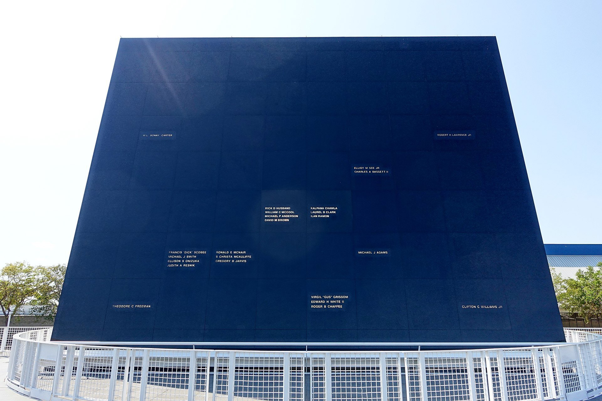 The Space Mirror Memorial at the KSC honors those who died in NASA missions, their names engraved in the black granite and reflected by sunlight. Courtesy of Wikimedia Commons.