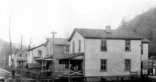 View of the foremen housing likely from the 1940s. The home pictured on the left was traditionally reserved for the town's doctor.