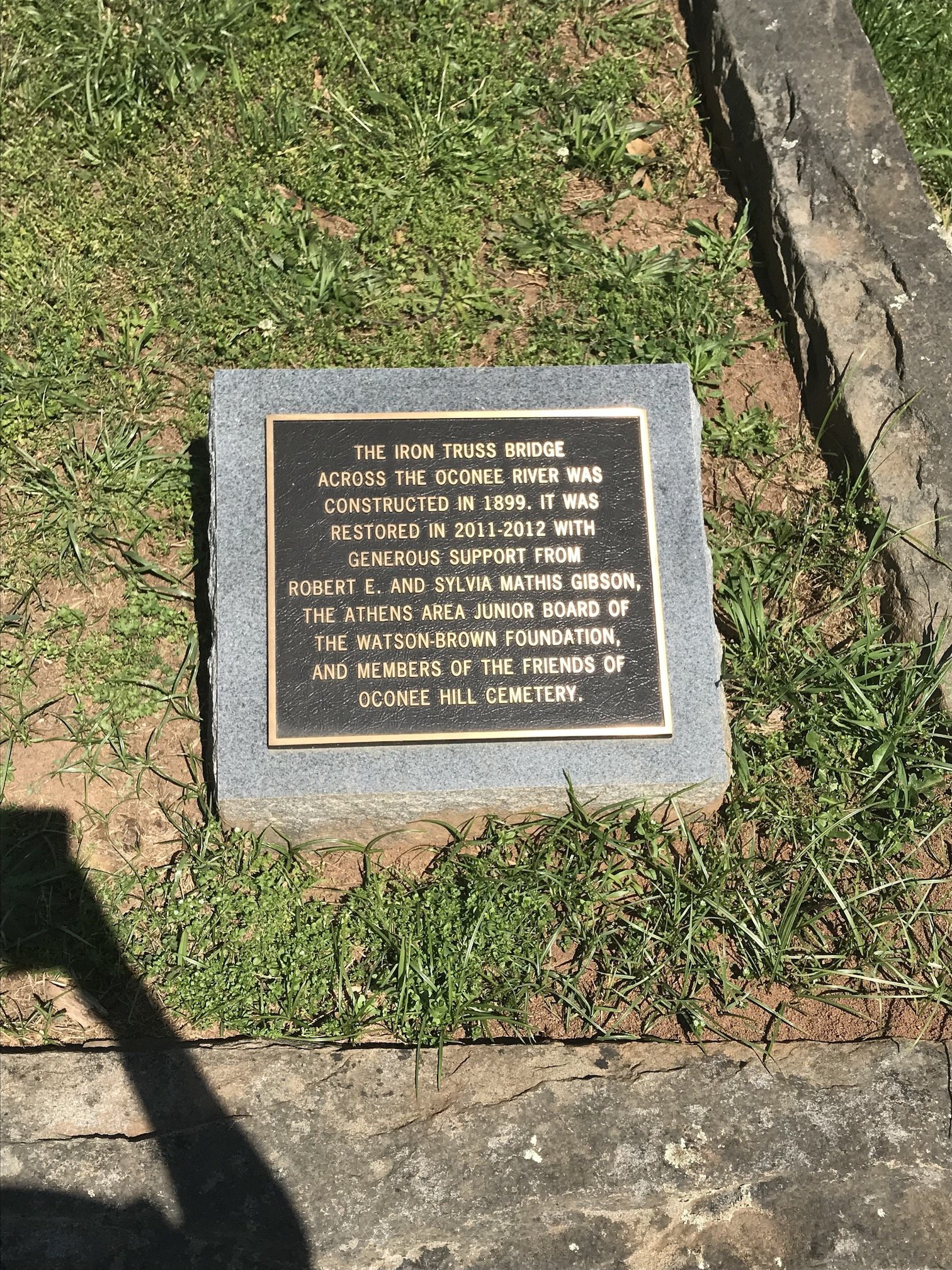 Marker describing the Iron Truss bridge that connects the older section of the cemetery to the newer