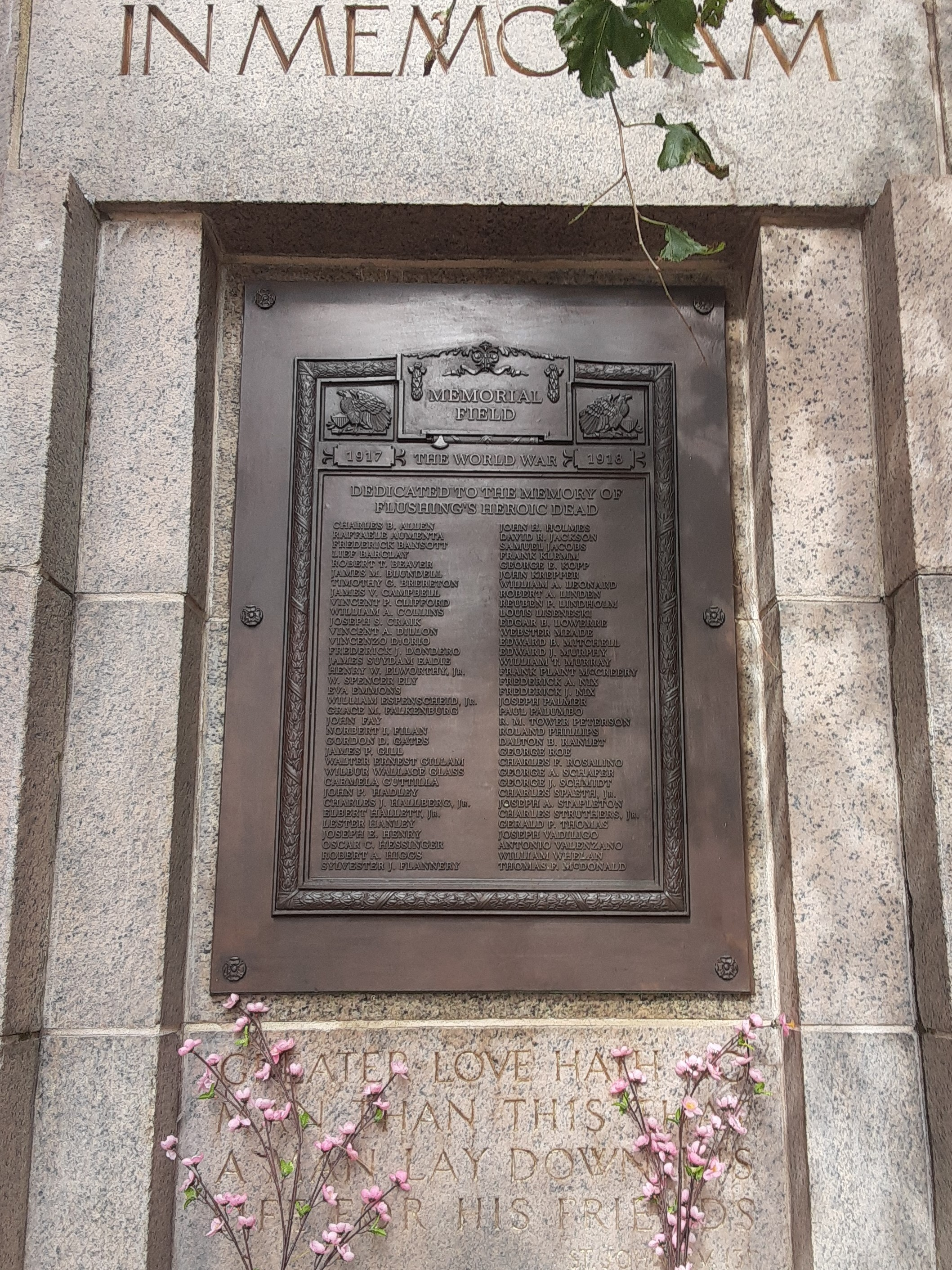 "The bronze plaque, with 70 names inscribed. The top reads ""In Memoriam"""