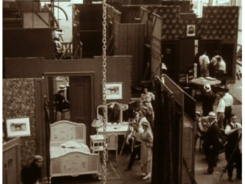 """A still from """"A Girl's Folly"""" showing the inside of the Paragon studio."""