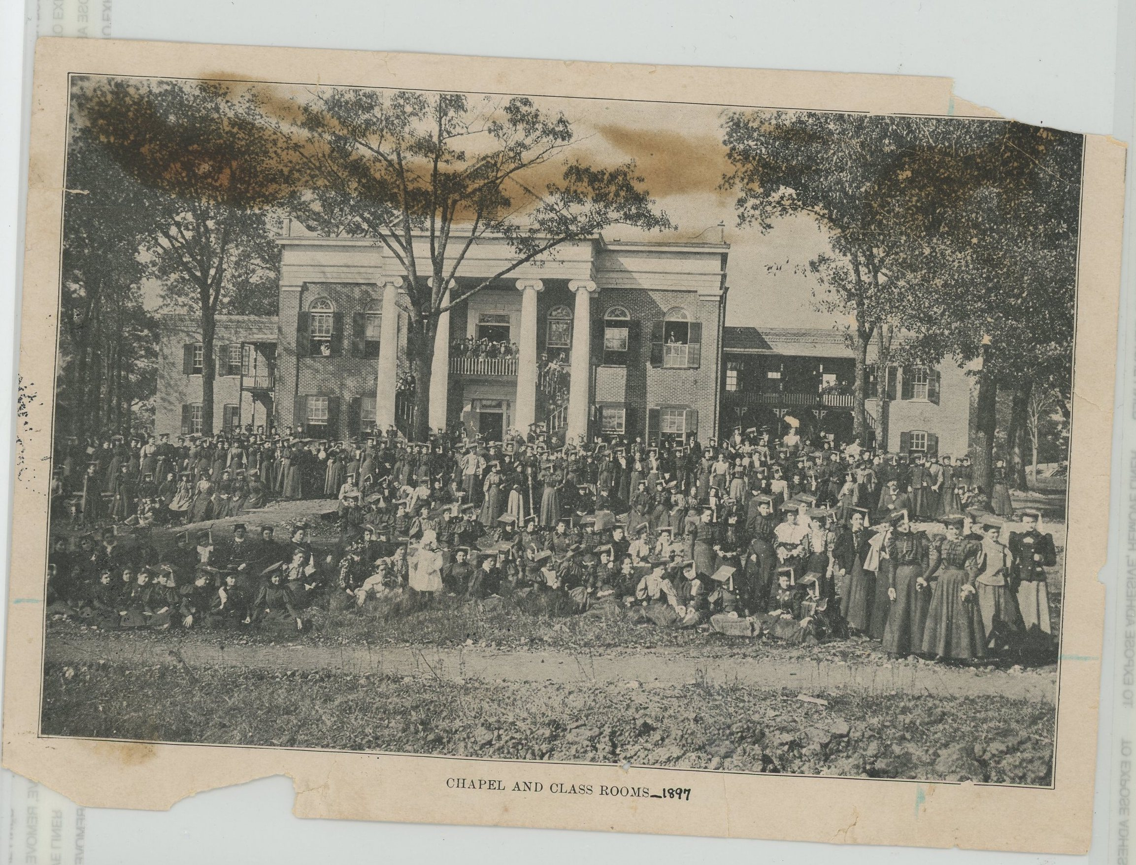 Students gathered in front of Reynolds Hall in 1897, not long after the school, then known as Alabama Girls' Industrial School, first opened.