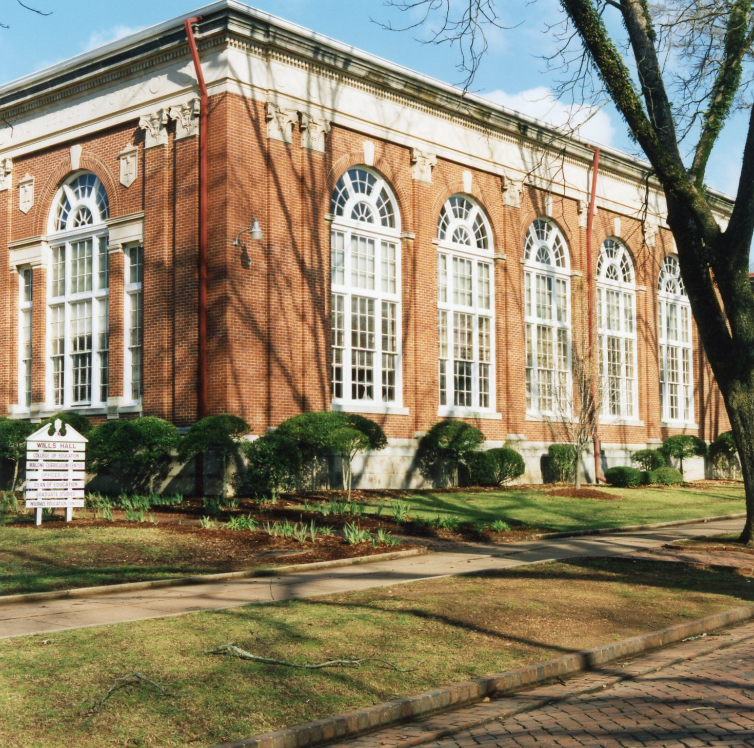 A scenic picture of Wills Hall in its still current role as the building for the College of Education.