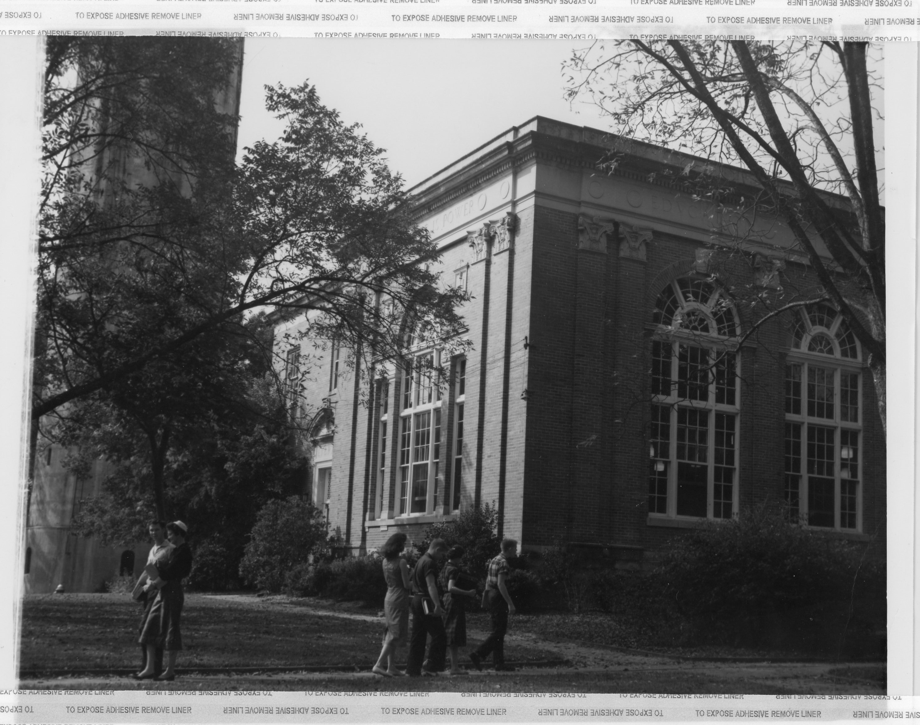 Wills Hall with student passing in front.