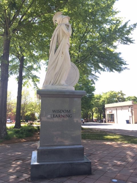 "North side view of Athena and her cloak; inscribed on the base are the words ""Wisdom"" and ""Learning"""