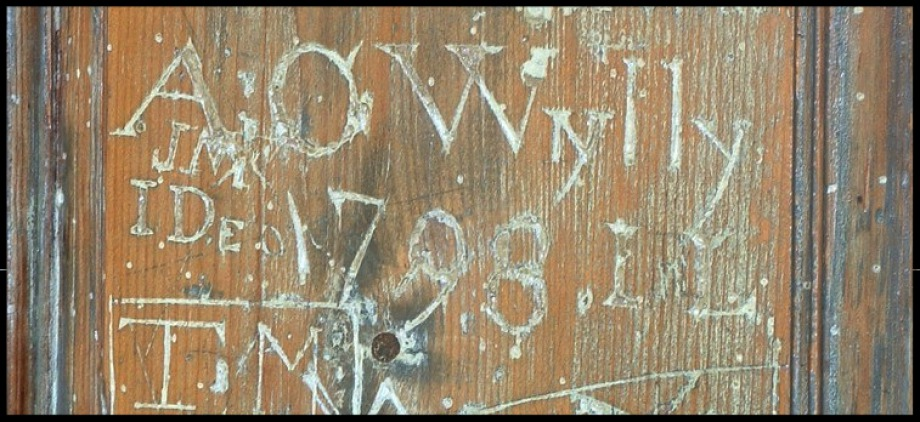 Graffiti on the door of Old Swedes dating to 1798. It was discovered during renovations and left as it was.