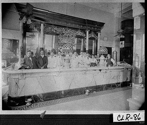 "Photograph of Costa family at opening of their soda fountain in the Southern Mutual Building in 1908, photo courtesy of the ""Vanishing Georgia"" collection, Georgia Archives."