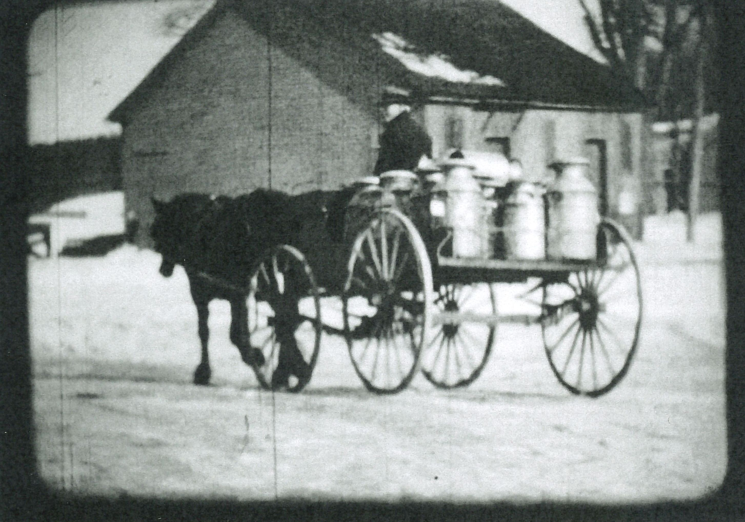 Still image of milk being delivered to the Contoocook Depot from film by Oscar Polhemus, circa 1930.
