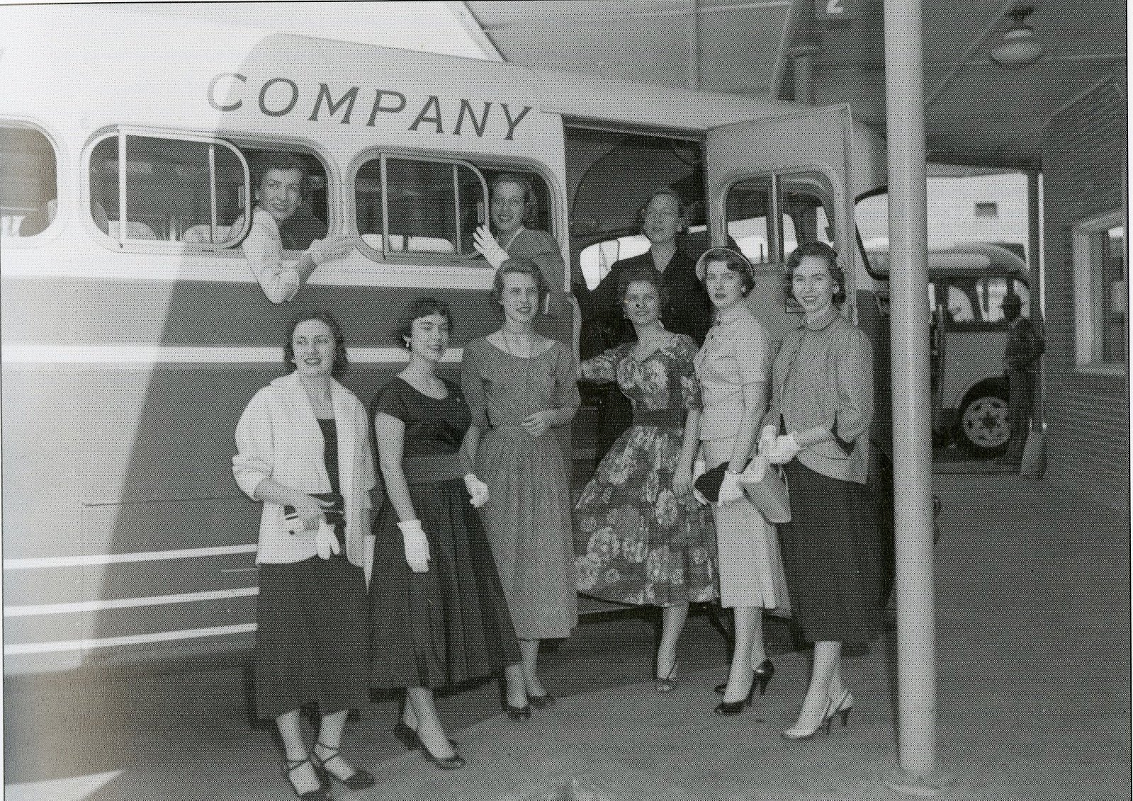 Some ladies posing while boarding their bus, c. 1950s.