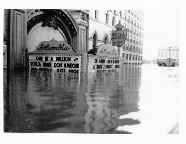 The movie theater underwater in the Great Flood of 1937, one of several natural disasters that damaged but failed to destroy the historic theater.