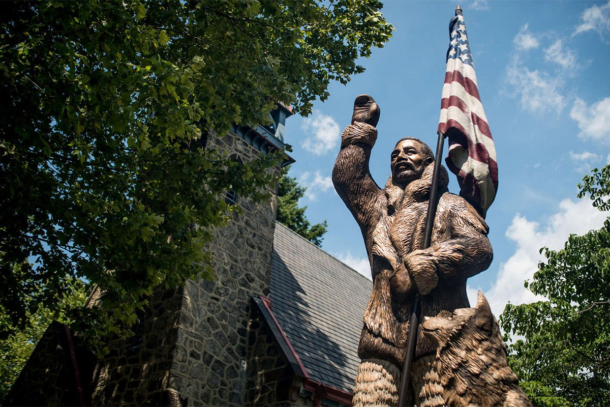 A statue in the front yard depicts famed African American explorer Matthew Henson, who journeyed on several expeditions to the North Pole with Robert Peary. Image obtained from the Philadelphia Inquirer.