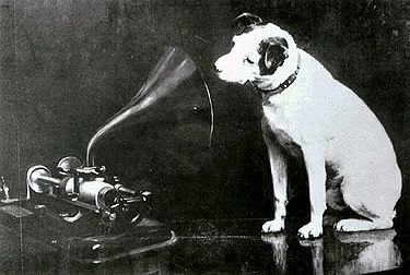 "Francis Barraud's original painting of Nipper looking into a phonograph and hearing ""His Master's Voice"""