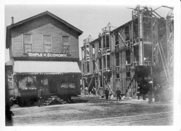 The Temple of Economy occupied the northeast corner of E. Main Street and Mechanic Avenue. The store's building was moved into the middle of Mechanic Avenue while the Shafer Block was built in 1899. The store would then relocate into the new building. The Owl Grill later occupied this building.