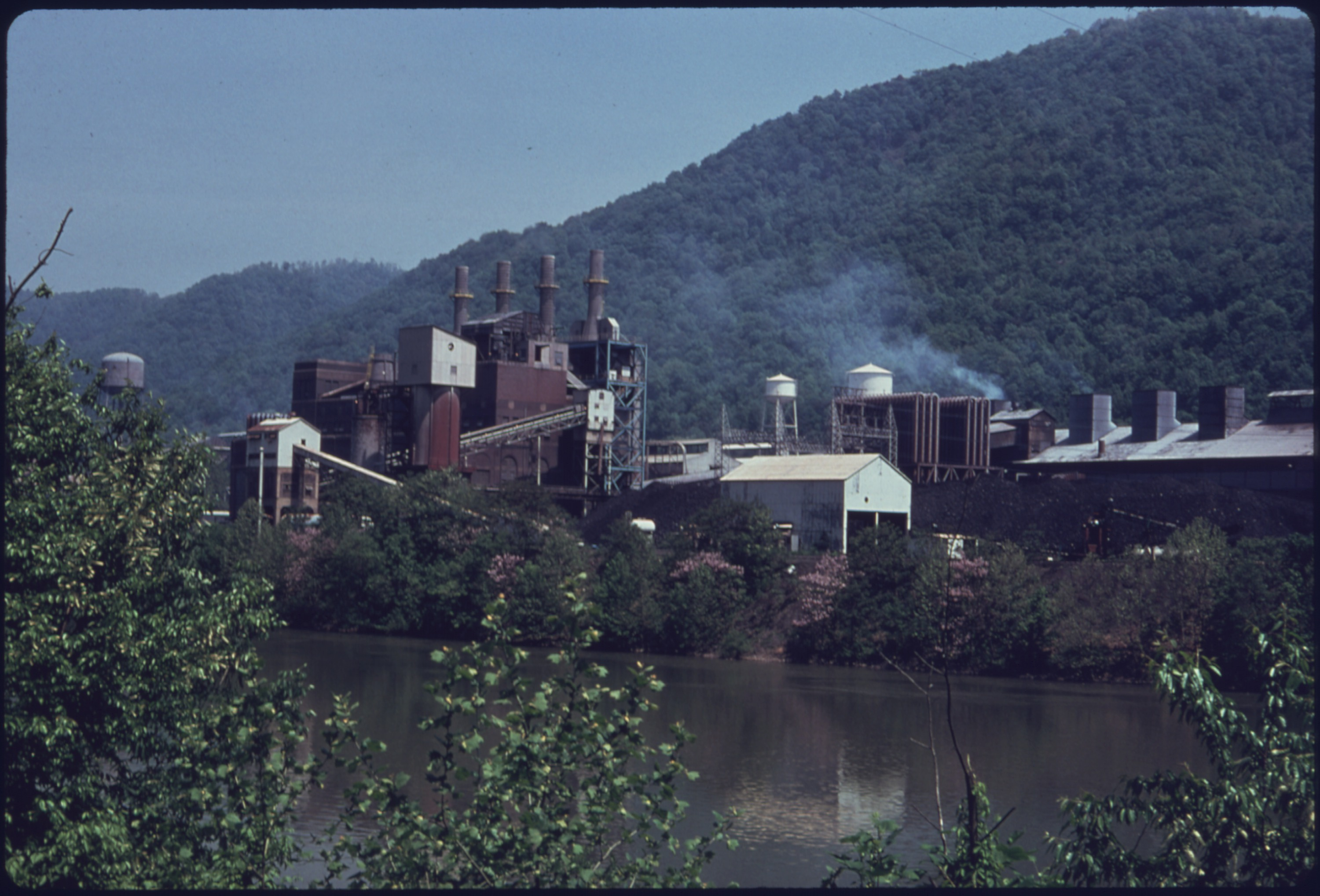 A picture of the plant from across the river circa 1975.
