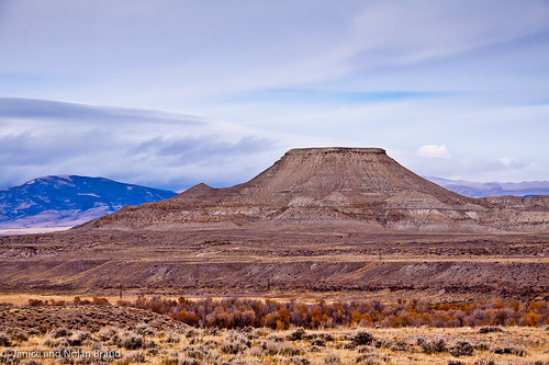 The rock formation is Crowheart Butte, where the Battle of Crowheart Butte took place.