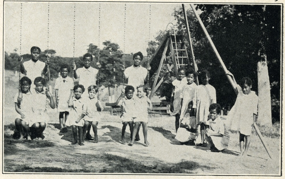 Children of the West Virginia Colored Orphan's Home playing on a swingset
