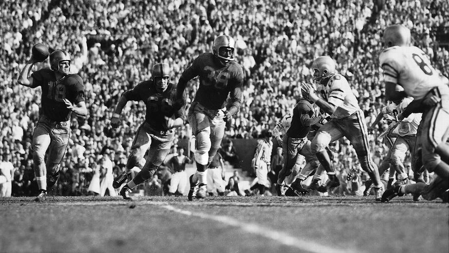 Bobby Grier (center) played in the 1956 Sugar Bowl as a fullback for the Pittsburgh Panthers. Though his team lost 7-0, his presence in the game signified the first time major college football in the South was integrated.