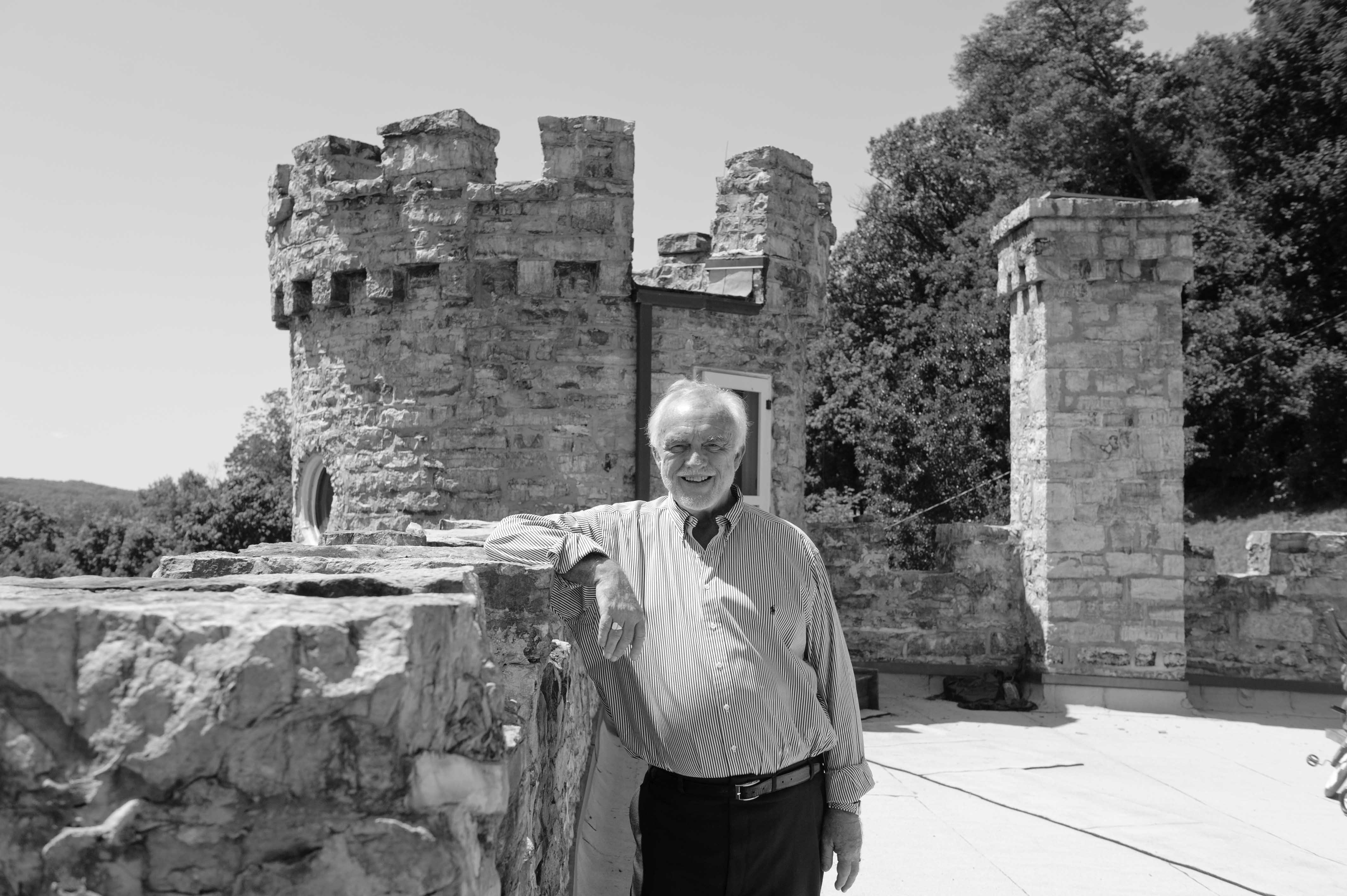 Andrew Gosline, one of the most recent owners, standing on the roof of the castle