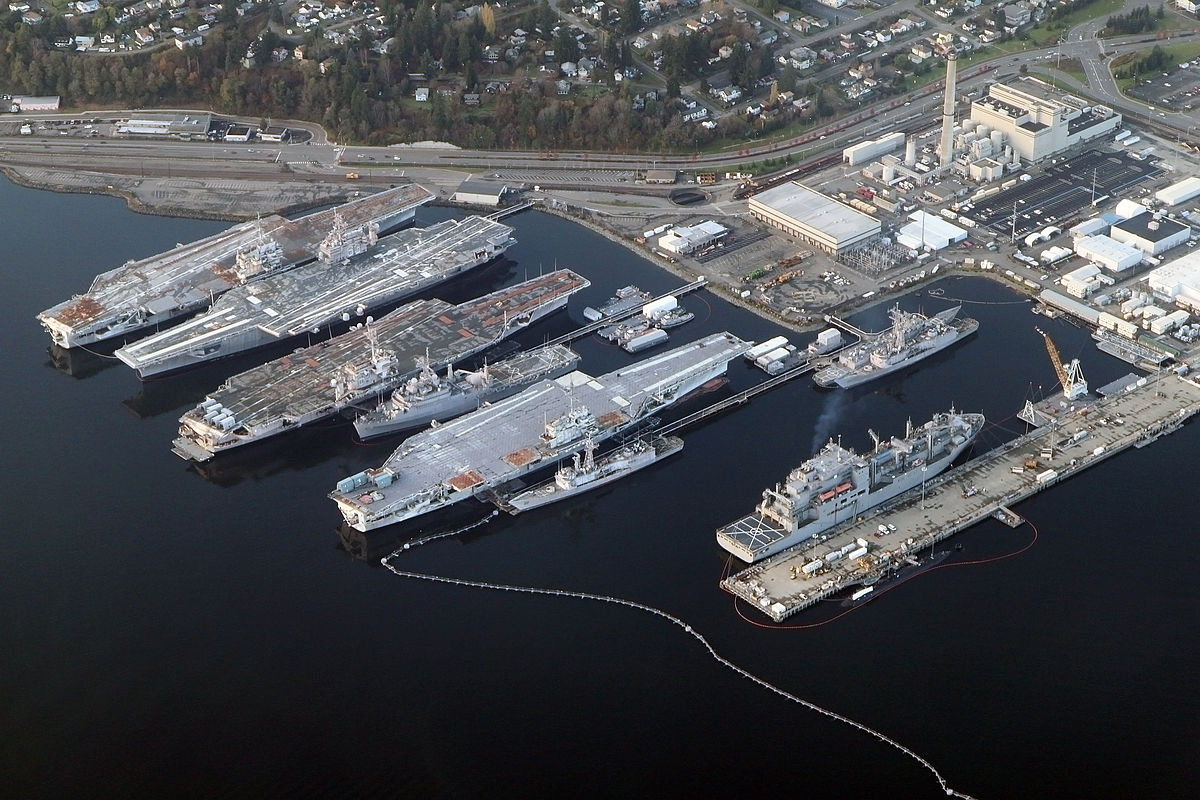 4 decommissioned aircraft carriers docked at the shipyard