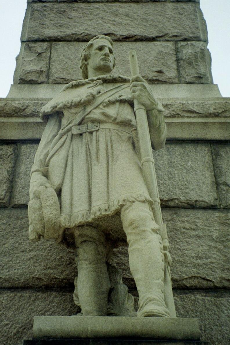 A sculpture at the base of the memorial obelisk depicting a Virginia frontiersman.