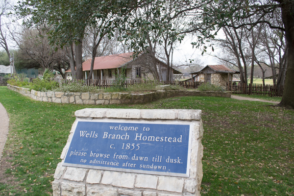 View of stone sign and Gault (Wells Branch) Homestead