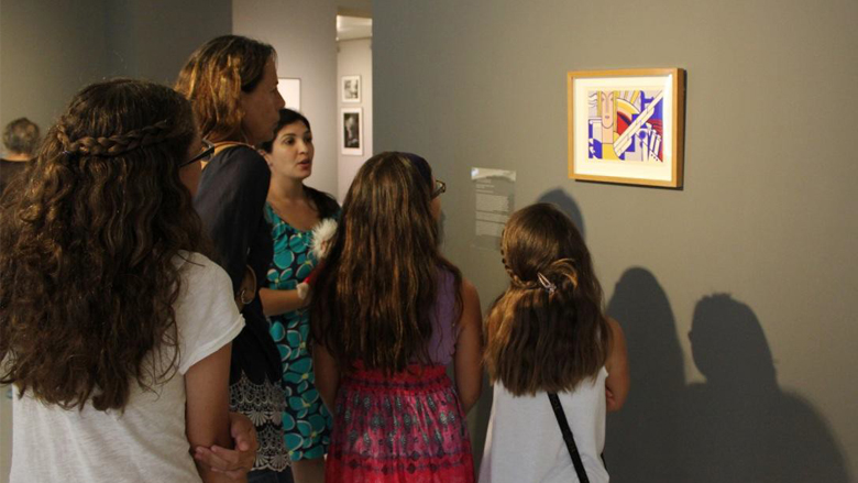 Museum educator, Ambar Alfaro providing tour of Pop Art for GO GO MOAD! Program, 2014. Credit: MOAD @ MOD