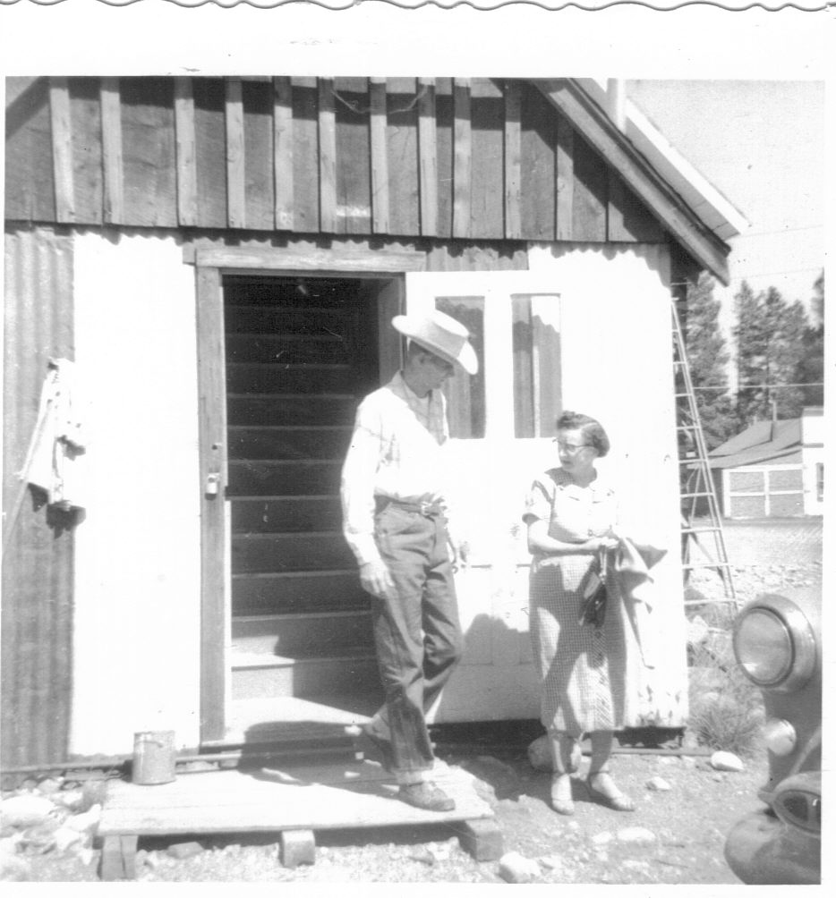 Teacher Alfred Boyd and his mother, at the rear of the schoolhouse, cicra 1956. Boyd lived in the second floor of the Schoolhouse.