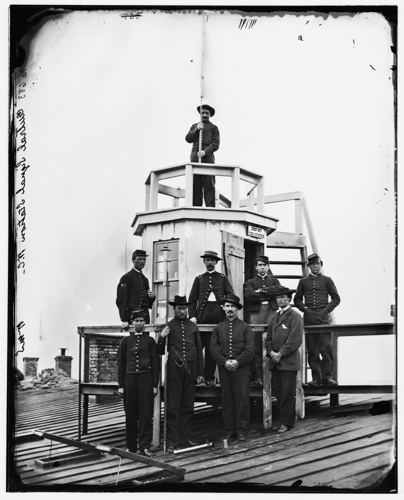 Signal Corps men stand at the Central Signal Station that was constructed atop the Winder Building in 1865.