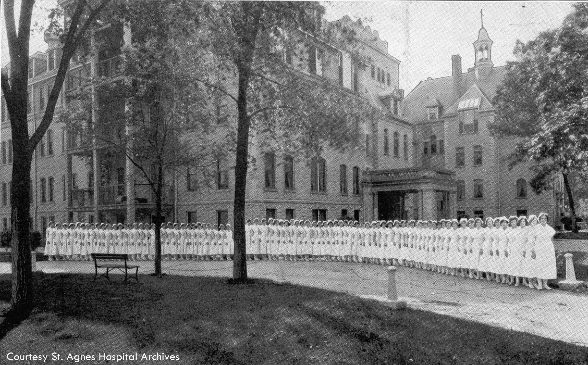 Nursing students stand outside St. Agnes Hospital, c. 1925.