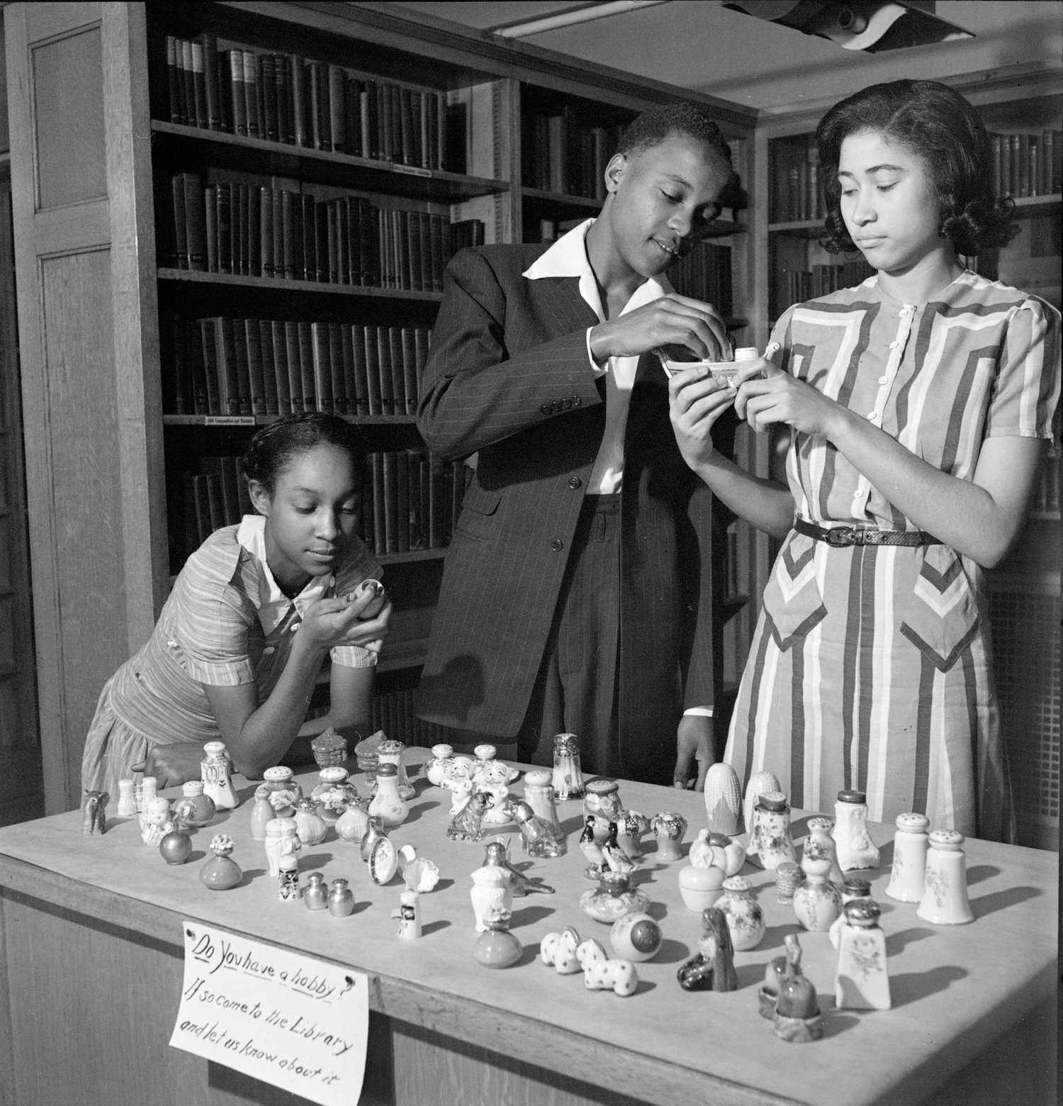 Vashon High School Students at a hobby show looking at collectible salt and pepper shakers, 1941.